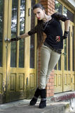 Edgy girl. Beautiful girl in punk and rock inspired outfit Stock Photo