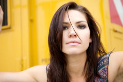 Edgy Girl with Yellow Backround. An Edgy Brunette with a yellow backround Royalty Free Stock Photo