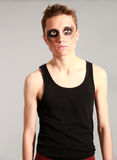 Edgy male model. Male fashion model with black eyes Stock Photography