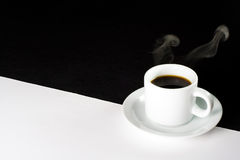 Edgy morning. Coffee on a divided black and white surface. Day and night Royalty Free Stock Photo