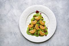 Free Edible Christmas Tree From Kiwi Slices On A Black Plate.Top View With Copy Space Stock Photo - 155772900