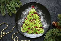 Free Edible Christmas Tree From Kiwi Slices.Top View. Royalty Free Stock Image - 125870796