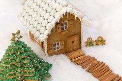 Edible cookie house in the snow royalty free stock images