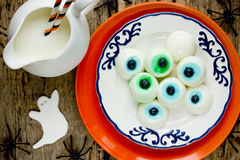 Edible eyeball on Halloween party for kids. Top view Royalty Free Stock Images