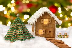 Edible gingerbread house and cookie christmas tree stock images