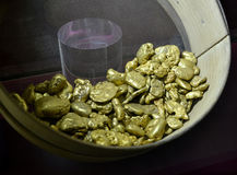 Edible gold pieces exposed by Italpreziosi in Milan. Royalty Free Stock Photography
