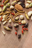 Edible insects and nuts Stock Photos