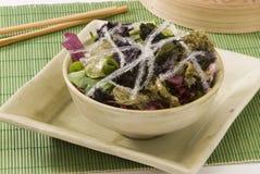 Edible seaweed salad. Assorted edible seaweed salad in a ceramic bowl. Selective focus Stock Photo
