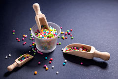 Edible sugar pearls for food decoration with wood scoops Stock Photos