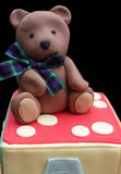 Edible teddy bear model on an alphabet block cake Stock Images