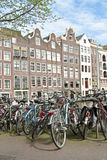 Edieval facades and lots of bicycles in Amsterdam Royalty Free Stock Photos