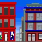 Edifícios altos com uma loja de vestido Foto de Stock