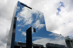 An edifice in Rotterdam, reflecting the sky. When I went pass Rotterdam train station, I saw this tall buiding reflecting the sky, it was very beautiful en it stock image