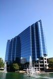 Edificio azul en el lago Fotografía de archivo