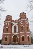 Edificio de ladrillo rojo con cuatro torres Imagen de archivo