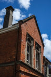 Edificio de ladrillo rojo viejo Imágenes de archivo libres de regalías