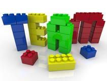 Edificio de personas con los bloques del juguete Foto de archivo libre de regalías