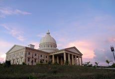 Edificio del capitolio de Palau en la puesta del sol Imágenes de archivo libres de regalías