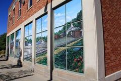 Edificio histórico viejo con la pintura de los barcos que suben el canal misterioso, museo misterioso del canal, Syracuse, Nueva  Imágenes de archivo libres de regalías