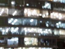 Edificio per uffici delle finestre di Blured per il fondo fotografia stock