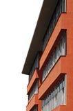 Edificio scolastico con le finestre enormi sopra priorità bassa bianca Immagine Stock Libera da Diritti