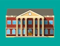 Edificio scolastico Facciata del mattone con gli orologi Immagini Stock