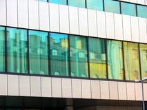 Edificio viejo en un nuevo edificio Foto de archivo