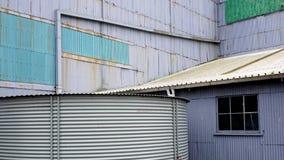 Edificios de acero acanalados viejos Imagen de archivo libre de regalías