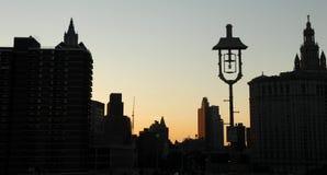Edificios de NYC en la puesta del sol Foto de archivo libre de regalías