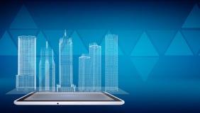 Edificios del alambre-marco que brillan intensamente en la PC de la tableta de la pantalla Imagen de archivo libre de regalías