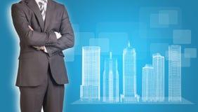 Edificios del hombre de negocios y del alambre-marco encendido Imagen de archivo libre de regalías