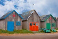 Edificios en el embarcadero de la pesca Foto de archivo libre de regalías