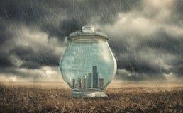 Edificios en un tarro de cristal Imagenes de archivo