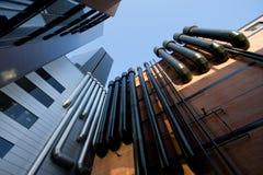 Edificios urbanos con los tubos Imágenes de archivo libres de regalías