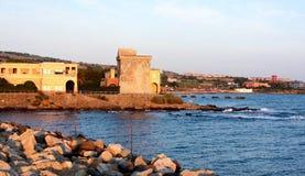 Edificios viejos en el mar - Civitavecchia, Italia Foto de archivo