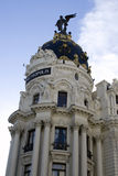 Edifico Metropolis. The landmark Metropolis building in Madrid.  The statue on the dome represents the Winged Victory Royalty Free Stock Image