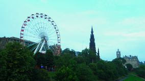 Time lapse of the ferris wheel and the Scott Monument stock footage
