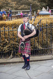 Edinburgh bagpiper street performing Royalty Free Stock Photo