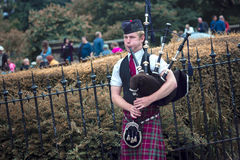 Edinburgh bagpiper street performing Royalty Free Stock Image