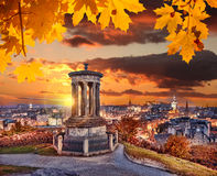 Edinburgh with Calton Hill against autumn leaves in Scotland Royalty Free Stock Photography