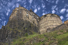 Edinburgh Castle. A view looking up at Edinburgh Castle, with a speckled sky Stock Photos