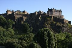 Edinburgh Castle. Is a castle fortress which dominates the sky-line of the city of Edinburgh, Scotland, from its position atop the volcanic Castle Rock. Human stock photos