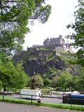 Edinburgh castle. Upon a rock face seen from princess street. With princess street gardens stock photos
