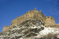 Edinburgh castle. View looking up at snowy Edinburgh castle from grass Market royalty free stock photography