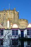 Edinburgh castle building on the hill above the Old Town. Building in the Edinburgh castle complex on the hill above an apartment building in the historic Stock Images