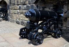 Edinburgh Castle cannons. Edinburgh Castle houses the Stone of Destiny, the Honors of Scotland, several museums and is also one of the enclaves of the Scottish royalty free stock image