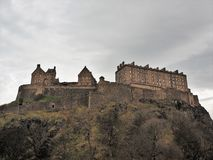 Edinburgh Castle on Castle Rock. Edinburgh Castle sits on Castle Rock in the Scottish Capital City of Edinburgh.  The Caste is a major tourist attraction and royalty free stock photography