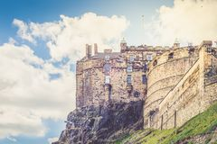 Edinburgh Castle on Castle Rock in Edinburgh, Scotland,. UK during nice Spring Sunny Day with clear Blue Sky, Toned Image Stock Photo