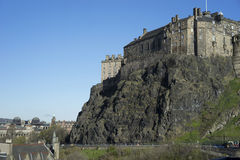 Edinburgh Castle on extinct volcano. Edinburgh Castle was built on an extinct volcano called Castle Rock in Edinburgh, Scotland. People have lived on Castle Rock royalty free stock image