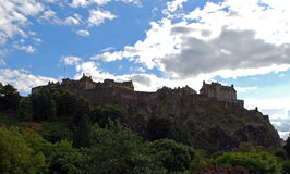 Edinburgh castle. This famous structure is Edinburgh castle and is built on top of volcanic rock . It is a major tourist attraction and is still used by the stock photography
